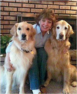 Gretchen Ford has trained many therapy dogs over the years, including Toby (left) and Charlie.