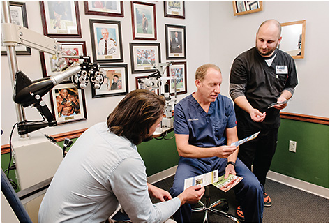 Kyle Wenzel, COA (right), assists Robert J. Weinstock, MD, during a patient consultation.
