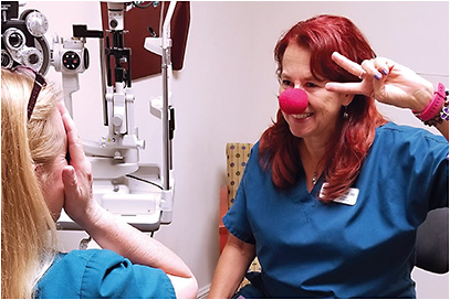 When checking peripheral vision, Ms. Scanlon occasionally puts on her red, foam clown nose.