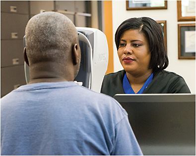 Shaleria Terrell, ophthalmic technician, performs testing with a Marco Nidek autorefractor.