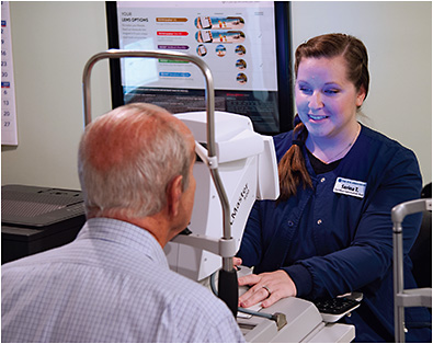 Serina Tindell, COA, performs biometry measurements to calculate a patient's IOL power.