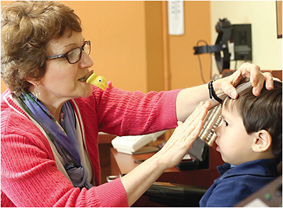 Mary DeYoung-Smith, CO, COMT, uses props to examine a patient. COURTESY OF CHILDREN'S EYE CARE OF MICHIGAN